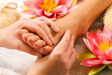 Reflexology & Aromareflex. Library Image: Foot with Flower